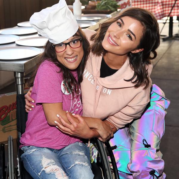 Miracle Pelayo and Olivia Culpo hugging
